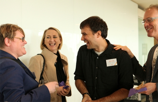 Speakers and attendees networking at Swarm 2014