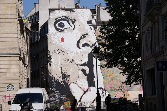 Street art showing man with finger to lips
